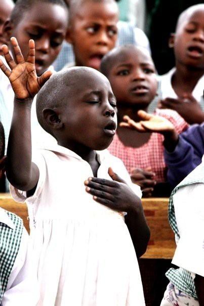 worshipping african boy